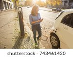 young woman is standing near... | Shutterstock . vector #743461420