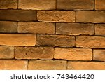 Small photo of abstract background texture or wallpaper of hard rough rectangular arranging brownish multiple bricks overlapping as an old rustic rural wall