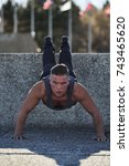 Small photo of Male athlete doing Incline push ups outside, Montreal, Quebec, Canada
