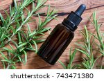 a bottle of rosemary essential... | Shutterstock . vector #743471380
