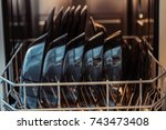 an open dishwasher with clean... | Shutterstock . vector #743473408