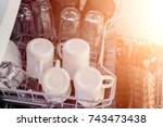 an open dishwasher with clean... | Shutterstock . vector #743473438