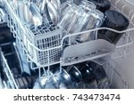 an open dishwasher with clean... | Shutterstock . vector #743473474