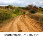 dirt road with puddles and mud  ... | Shutterstock . vector #743482414