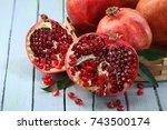 opened pomegranates | Shutterstock . vector #743500174