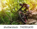 Sport. A cyclist on a bike with a mountain bike in the forest - stock photo