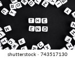the end.  playing words puzzle. ...   Shutterstock . vector #743517130