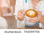 coffee latte art on woman hand... | Shutterstock . vector #743559754