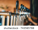 beer tap in restaurant lager... | Shutterstock . vector #743585788