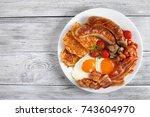 full hot english breakfast  ... | Shutterstock . vector #743604970