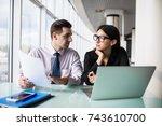 business partners working on... | Shutterstock . vector #743610700