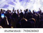 hand with a smartphone records... | Shutterstock . vector #743626063