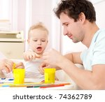young  happy family in a room... | Shutterstock . vector #74362789