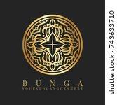 golden batik flower logo | Shutterstock .eps vector #743633710