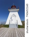 Small photo of Cape Enrage Lighthouse in the Bay of Fundy. New Brunswick, Canada.