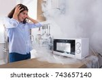 unhappy young woman looking at...   Shutterstock . vector #743657140