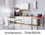 interior of modern kitchen with ... | Shutterstock . vector #743658334