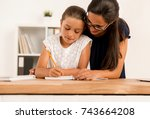 young mother helping her...   Shutterstock . vector #743664208