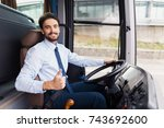 the driver of the tourist bus... | Shutterstock . vector #743692600