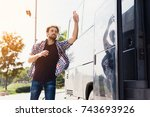 the guy runs after the bus that ... | Shutterstock . vector #743693926