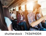 the girl is sitting on the bus... | Shutterstock . vector #743694004
