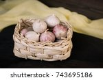 garlic in a basket on a dark... | Shutterstock . vector #743695186