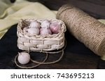 garlic in a basket on a dark... | Shutterstock . vector #743695213