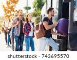 a group of tourists enters the... | Shutterstock . vector #743695570