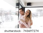 romantic happy young couple... | Shutterstock . vector #743697274