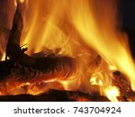 Small photo of Fire flames of a bonfire on a black background. Bright hot campfire burning at night. Wood pile was ignited. Balefire or blaze is for hiking, pagan and ancient traditions, natural lifestyle, devil etc