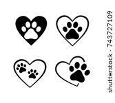 cat and dog paw print inside... | Shutterstock .eps vector #743727109