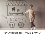 handsome young guy in apron is... | Shutterstock . vector #743817940