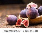 figs. a few figs in a bowl on... | Shutterstock . vector #743841358