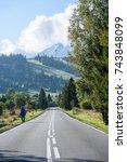 empty asphalt road in the... | Shutterstock . vector #743848099