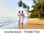 romantic couple walking... | Shutterstock . vector #743867764