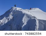 climbing on mountain in winter. ... | Shutterstock . vector #743882554