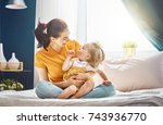 mom and her daughter child girl ... | Shutterstock . vector #743936770