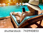 bikini woman sexy in pool... | Shutterstock . vector #743940853