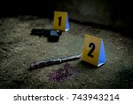 crime marked evidence with... | Shutterstock . vector #743943214