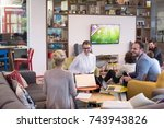 group of a young business... | Shutterstock . vector #743943826