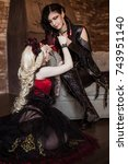 Small photo of Gothic aristocrat, a vampire holds a woman's hand. Beautiful princess with a demon. Visual kei, aristocrat. Fairy tale, fantasy.