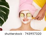 relax  woman in a cosmetic mask ... | Shutterstock . vector #743957320