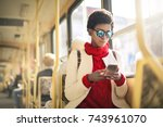 Girl Sitting In A Bus  Using...