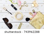 Small photo of Fashion blog gold style desk with woman accessory collection. Flat lay