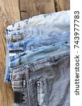 various colors jeans on a... | Shutterstock . vector #743977783