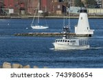 Small photo of New Bedford, Massachusetts, USA - October 27, 2017: Fishing boat Allegiance leaving New Bedford with Palmer's Island lighthouse in background