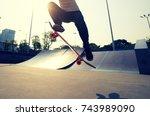 skateboarder legs skateboarding ... | Shutterstock . vector #743989090