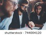 concept of teamwork process at... | Shutterstock . vector #744004120
