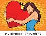 beautiful young woman hugging... | Shutterstock . vector #744038548
