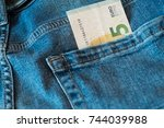 a 5 euro banknote in a pocket....   Shutterstock . vector #744039988